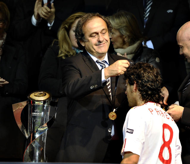 UEFA President Michel Platini (L) hands over a medal to Daniel Parejo of Spain after Spain won the European Under-21 Championship final football match between Switzerland and Spain at NRGI Park Stadium in Arhus Stadion Denmark on June 25, 2011. AFP PHOTO Henning Bagger/SCANPIX DANMARK (Photo credit should read HENNING BAGGER/AFP/Getty Images)
