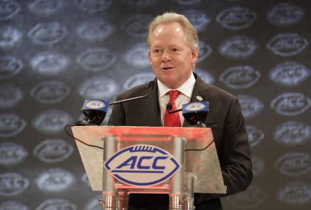 Louisville head coach Bobby Petrino answers a question during a news conference at the NCAA Atlantic Coast Conference college football media day in Charlotte, N.C., Thursday, July 19, 2018. (AP Photo/Chuck Burton)