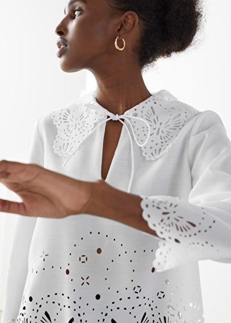 <p>The details of this <span>& Other Stories Wide Embroidered Scalloped Blouse</span> ($62, originally $89) are beautiful.</p>