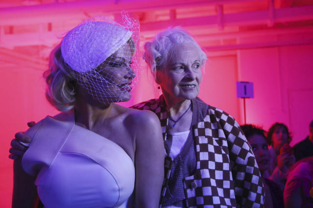 Actress Pamela Anderson, left, and designer Vivienne Westwood pose for photographers prior to the Vivienne Westwood Ready To Wear Spring-Summer 2020 collection, unveiled during the fashion week, in Paris, Saturday, Sept. 28, 2019. (Photo by Vianney Le Caer/Invision/AP)