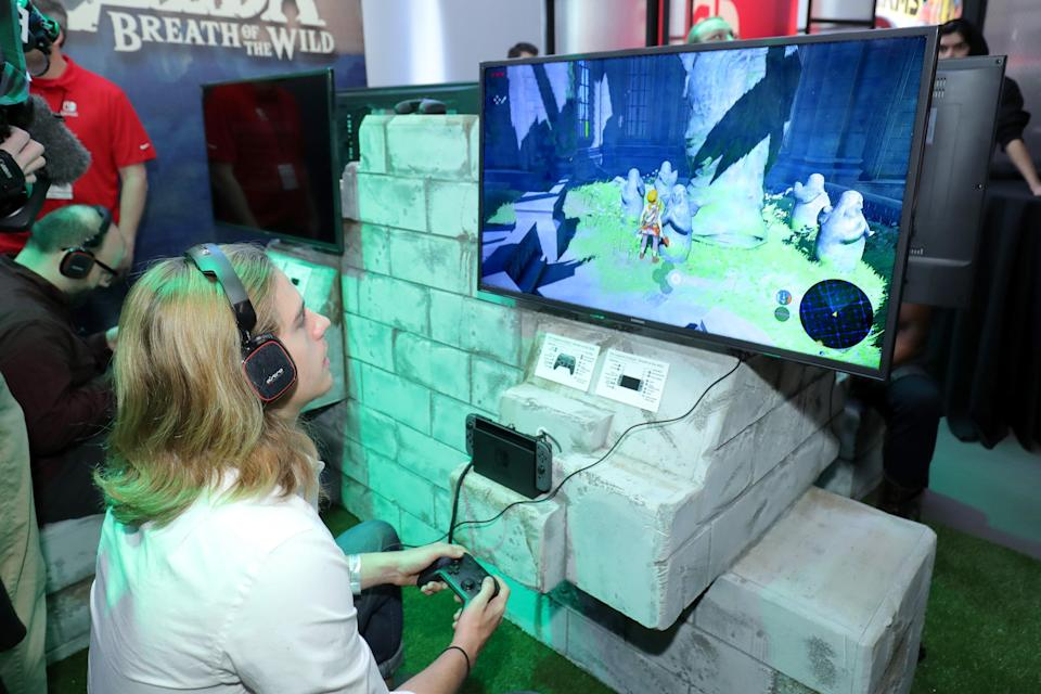 In this photo provided by Nintendo of America, a guest enjoys playing The Legend of Zelda: Breath of the Wild on the groundbreaking new Nintendo Switch at a special preview event in New York (Getty Images for Nintendo of Ame)