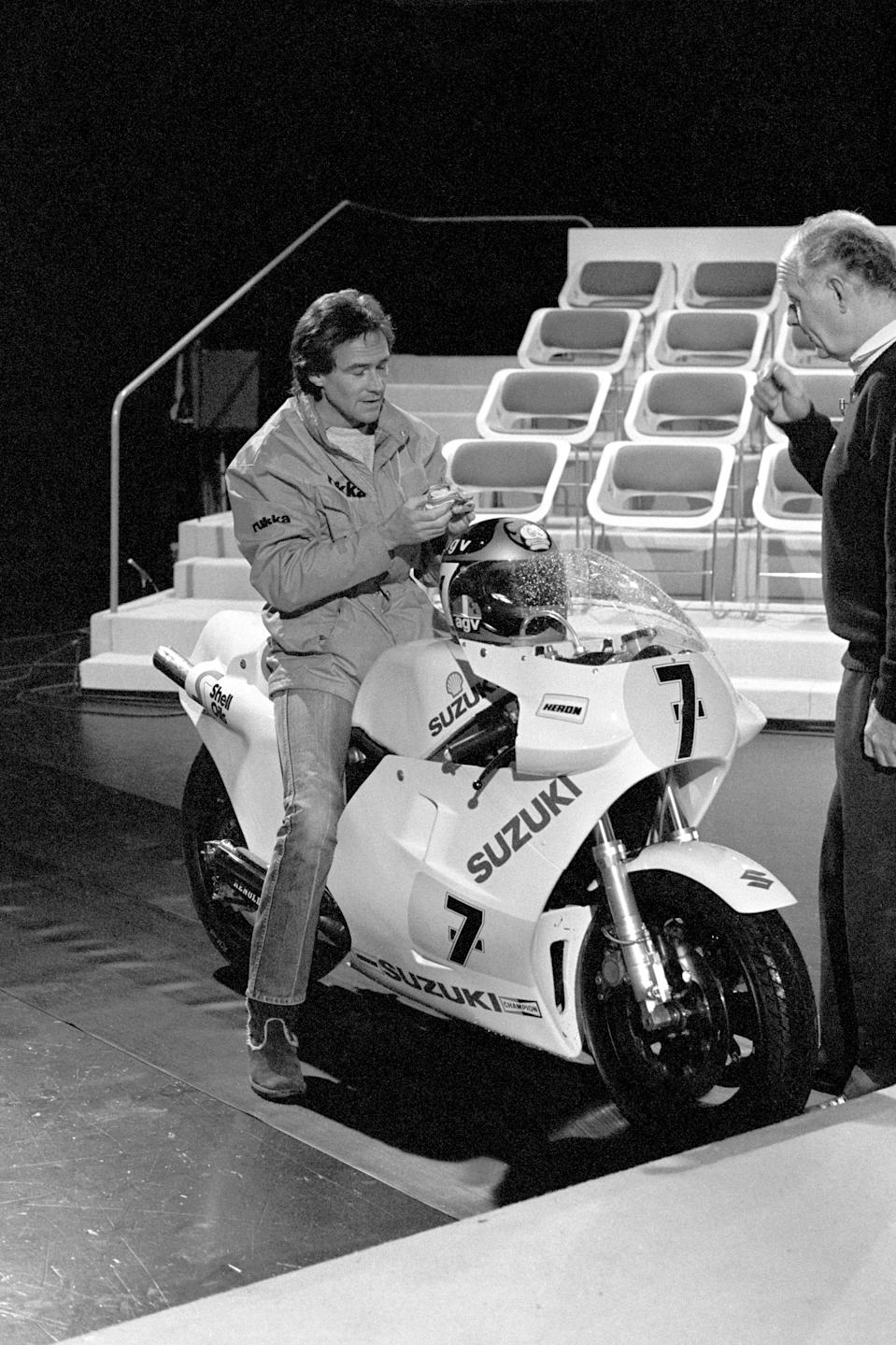 Motorcyclist Barry Sheene (l) talks to presenter Frank Bough (r) after riding into the studio, the first time he had ridden a motorcycle unaided since the horrific crash in which he broke an arm and both legs. (Photo by PA Images via Getty Images)