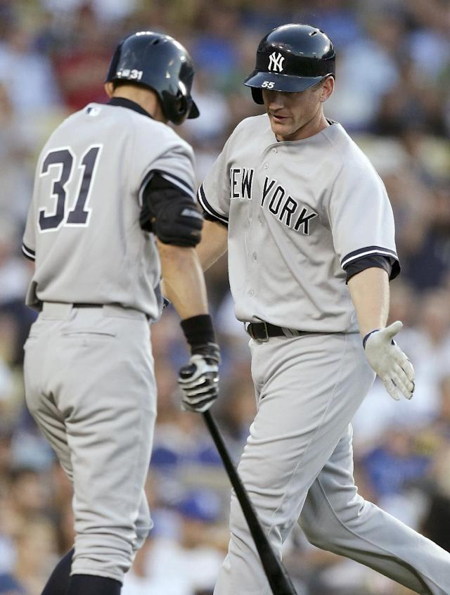 New York Yankees' Lyle Overbay, right, celebrates his home run against the Los Angeles Dodgers with Ichiro Suzuki during the second inning of a baseball game in Los Angeles, Tuesday, July 30, 2013. (AP Photo/Chris Carlson)