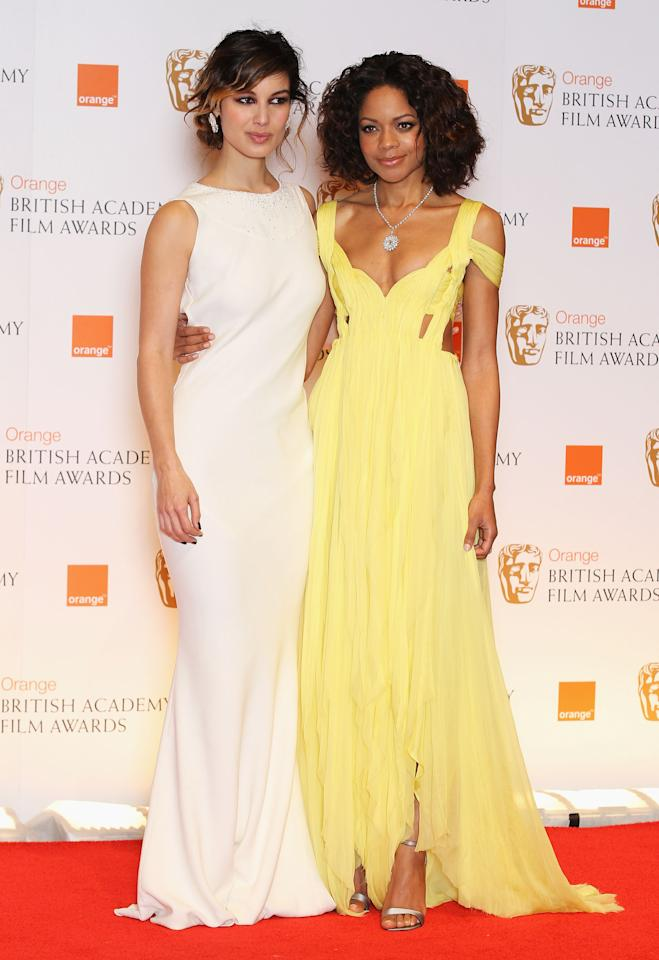 LONDON, ENGLAND - FEBRUARY 12:  Actresses Naomie Harris and Berenice Marlohe poses in the press room during the Orange British Academy Film Awards 2012 at the Royal Opera House on February 12, 2012 in London, England.  (Photo by Chris Jackson/Getty Images)