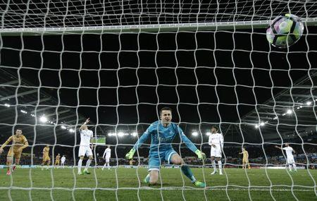 Swansea City's Lukasz Fabianski looks dejected after Tottenham's Dele Alli scored their first goal