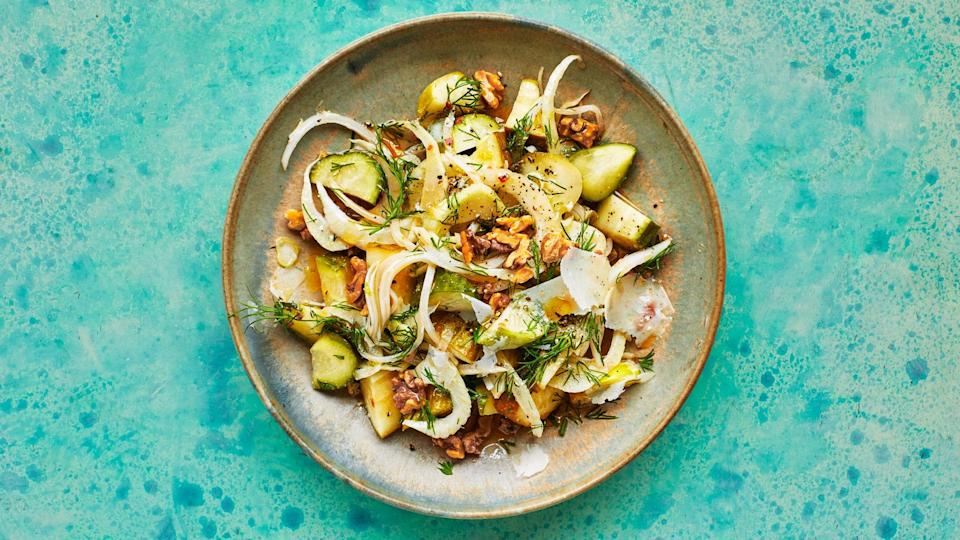 "A crunchy, squeaky pickle salad that would be amazing alongside a super fatty main dish, like <a href=""https://www.bonappetit.com/recipe/set-it-and-forget-it-roast-pork-shoulder?mbid=synd_yahoo_rss"" rel=""nofollow noopener"" target=""_blank"" data-ylk=""slk:this giant pork roast"" class=""link rapid-noclick-resp"">this giant pork roast</a>. But don't worry, it's not one briny mouthful, there are a lot of different textures going on between the crisp onions, juicy pickles, and crunchy nuts. We tend to favor pickles that are bright with acid and low on sugar; anything labeled ""half-sour"" usually fits the bill. If using sweeter pickles, add a bit more vinegar and salt. And honestly, you can use whatever pickles you want in this (radishes! Green beans!). <a href=""https://www.bonappetit.com/recipe/crunchy-pickle-salad?mbid=synd_yahoo_rss"" rel=""nofollow noopener"" target=""_blank"" data-ylk=""slk:See recipe."" class=""link rapid-noclick-resp"">See recipe.</a>"