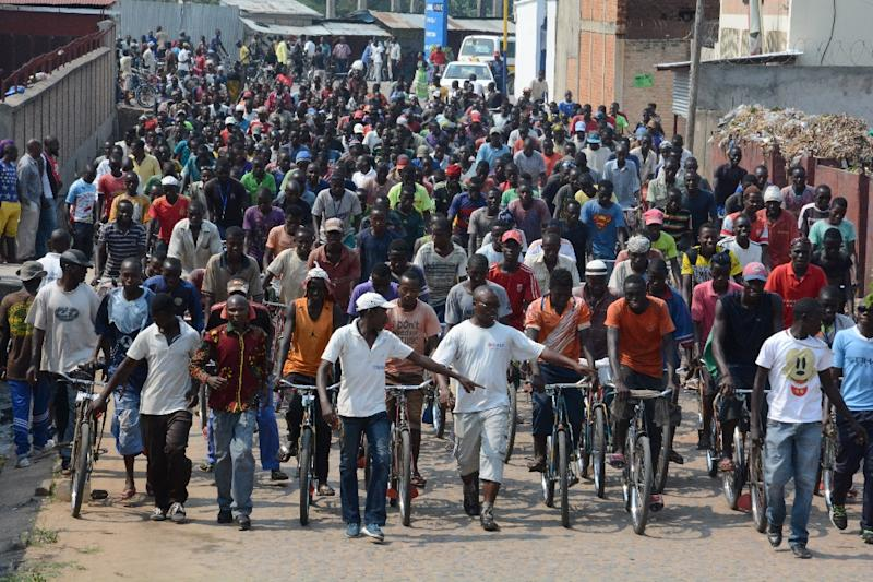 People gather to demonstrate outside the office of the United Nations Human Rights Commissioner in Bujumbura, against a report by investigators tasked by the UN Human Rights Council with probing rights abuses in Burundi