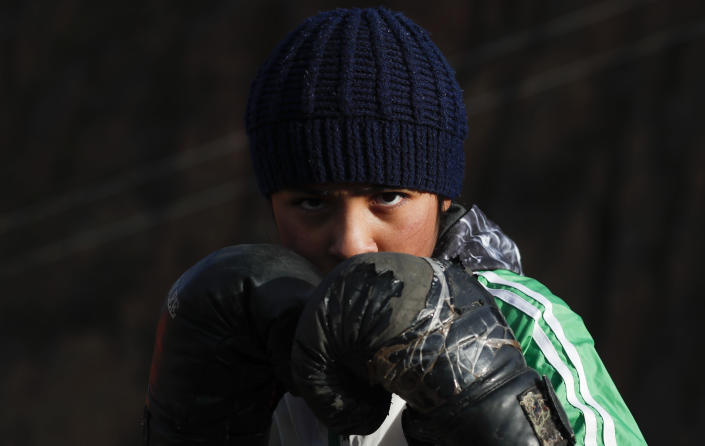 Gracce Kelly Flores, a 12-year-old boxer who goes by the nickname Hands of Stone, poses for a photo during her daily boxing workout as she trains under the coaching of her father in Palca, Bolivia, early Thursday, June 10, 2021, amid the COVID-19 pandemic. At age 8, Flores defeated a 10-year-old boy, and with three national boxing medals under her belt, she dreams of reaching the women's boxing world championship. (AP Photo/Juan Karita)