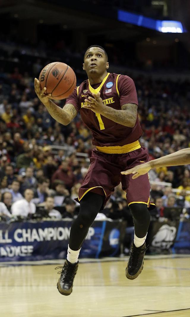 Arizona State guard Jahii Carson (1) drives to the basket during the first half of a second round NCAA college basketball tournament game against the Texas Thursday, March 20, 2014, in Milwaukee. (AP Photo/Morry Gash)