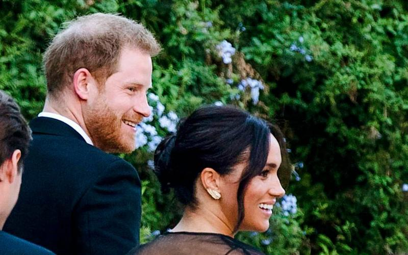 Britain's Prince Harry and his wife Meghan, Duchess of Sussex arrive to the wedding of Misha Nonoo and Michael Hess in Rome, Friday - ANSA