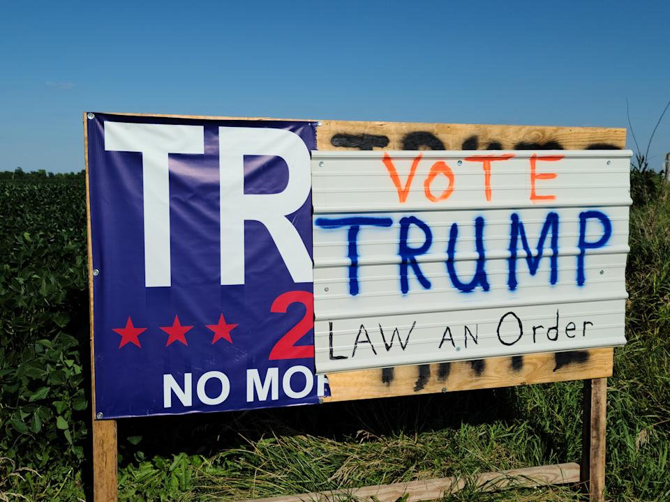 A large political sign near Attica in central Iowa has been through at least four iterations because of vandalism and updates.