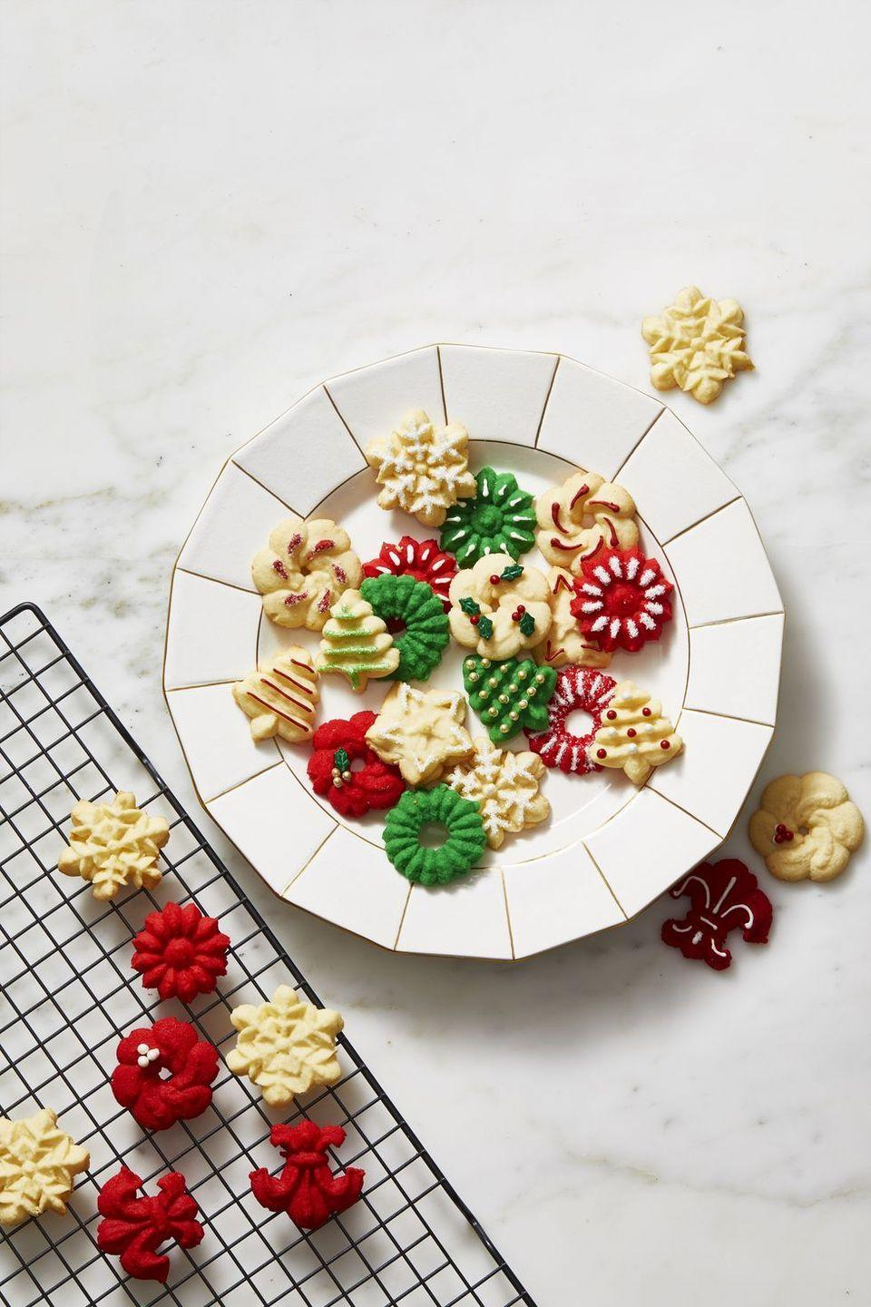 """<p>They may look store-bought, but with the help of a cookie press, these buttery treats are super simple to make at home.</p><p><em><a href=""""https://www.goodhousekeeping.com/food-recipes/a11212/spritz-cookies-recipe-ghk1211/"""" rel=""""nofollow noopener"""" target=""""_blank"""" data-ylk=""""slk:Get the recipe for Holiday Spritz Cookies »"""" class=""""link rapid-noclick-resp"""">Get the recipe for Holiday Spritz Cookies »</a></em></p><p><a class=""""link rapid-noclick-resp"""" href=""""https://www.amazon.com/OXO-Grips-Cookie-Stainless-Storage/dp/B00ABH0PYI?linkCode=ogi&tag=syn-yahoo-20&ascsubtag=%5Bartid%7C10063.g.34851223%5Bsrc%7Cyahoo-us"""" rel=""""nofollow noopener"""" target=""""_blank"""" data-ylk=""""slk:SHOP NOW"""">SHOP NOW</a></p>"""