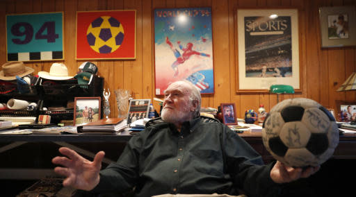 Dick Cecil, vice president and chief architect of the Atlanta Chiefs soccer club, holds a ball signed by the 1968 championship team at his home in Atlanta, Wednesday, Dec. 5, 2018. The Chiefs won the very first title in the North American Soccer League, beating the San Diego Toros 3-0 before a crowd of about 15,000 at Atlanta Stadium. (AP Photo/John Bazemore)
