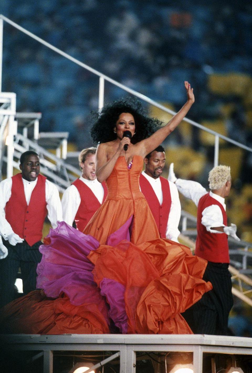 <p>Meanwhile, the living legend known as Diana Ross performed in 1996 and was the first person to really introduce the idea of a medley of hits to the show. More importantly, she wore this <em>incredible</em> dress. I wants it.</p>