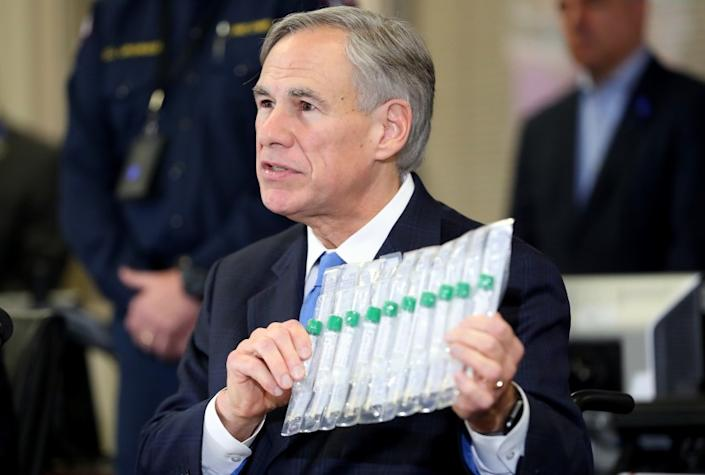 ARLINGTON, TEXAS - MARCH 18: Texas Governor Greg Abbott displays COVID-19 test collection vials as he addresses the media during a press conference held at Arlington Emergency Management on March 18, 2020 in Arlington, Texas. Abbott announced that Arlington health officials received 2,500 testing kits so all residents and workers at the Texas Masonic Retirement Home, the retirement home where COVID-19 victim Patrick James lived with his wife, will be tested for the virus. (Photo by Tom Pennington/Getty Images)