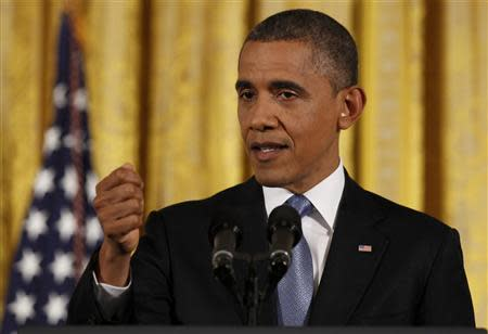 U.S. President Obama gestures during a news conference at the White House in Washington