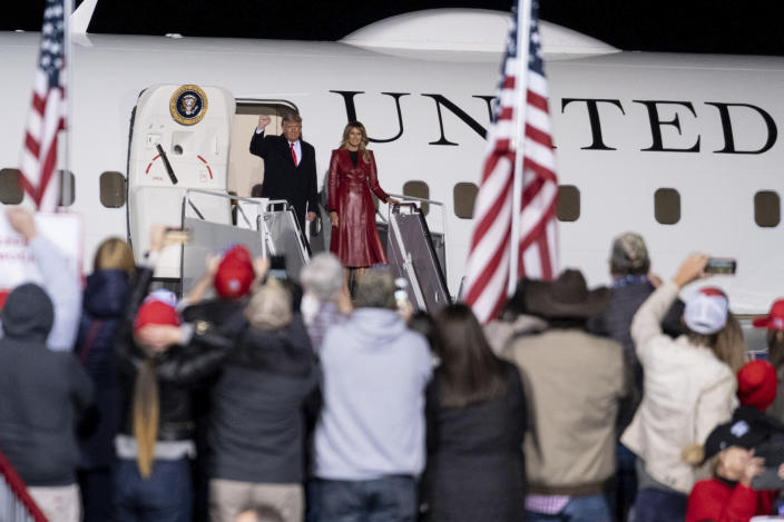 President Donald Trump and first lady Melania Trump arrive at a rally for U.S. Sens. Kelly Loeffler, R-Ga., and David Perdue, R-Ga., who are both facing runoff elections Saturday, Dec. 5, 2020 in Valdosta, Ga. (Ben Gray/AP)