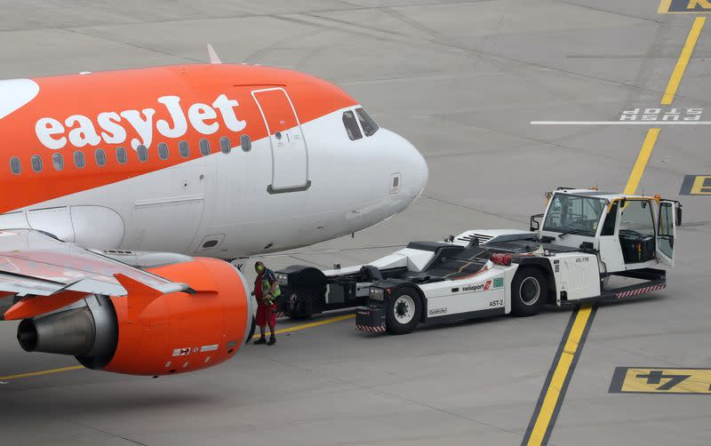 A Goldhofer pushback tractor of air services provider Swissport stands in front of an Easy Jet aircraft at Zurich Airport