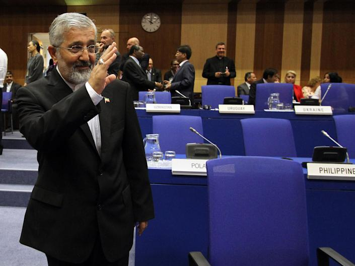 Iran's Ambassador to the International Atomic Energy Agency, IAEA, Ali Asghar Soltanieh waves as he arrives for the IAEA board of governors meeting at the International Center in Vienna, Austria, Monday, Sept. 10, 2012. (AP Photo/Ronald Zak)