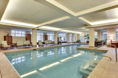 The lower level of the residence includes an impressive indoor pool facility. The pool includes lap lanes and recreation space for games such as volleyball. There is also a drop-down theater screen and cinema projector, in case you want to catch a flick without leaving the pool. A cabana bath and steam room are located off the pool deck, and an all-weather hot tub is just outside. LakefrontLuxuryAuction.com.