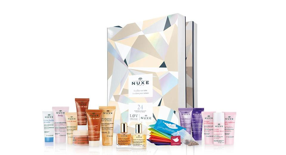 """<p>Nuxe's advent calendar contains 15 seriously-coveted beauty products from body scrubs to toning lotions. The £59 beauty must-have is now available <a rel=""""nofollow noopener"""" href=""""https://www.lookfantastic.com/nuxe-beauty-countdown/11853899.html?affil=thggpsad&switchcurrency=GBP&shippingcountry=GB&thg_ppc_campaign=71700000026979853&adtype=pla&product_id=11853899&gclid=Cj0KCQjwjbveBRDVARIsAKxH7vm-qtcXZoANFxEsB6MyLt_N5JuNCW61HT9Qz8tF6qhKURRzLEiDPpYaAgluEALw_wcB&gclsrc=aw.ds&dclid=CMb95ODQnN4CFUUu4AodPOMA6g"""" target=""""_blank"""" data-ylk=""""slk:online"""" class=""""link rapid-noclick-resp"""">online</a>. </p>"""