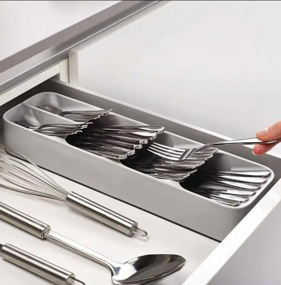 """Made to fit a full 24-piece cutlery set, but this sorter takes up half the space of a traditional organizer, freeing up so much extra storage in a drawer you never thought you could get back. More room in your drawers equals less clutter on your counters.<br /><br /><strong>Promising review:</strong>""""I have a tiny kitchen with only three drawers, so space is at a premium.<strong>My silverware organizer took up almost all of one drawer, so this organizer is a godsend. You can fit quite a few spoons etc. in each slot.</strong>My beater attachments fit perfectly into the top two hollows. I will say I have to flip my forks over face down in order to be able to shut and open my drawer, but then the drawer itself is kind of shallow.<strong>You NEED this if you have a small kitchen with few drawers!</strong>"""" —<a href=""""https://www.amazon.com/dp/B072R6CLRC?tag=huffpost-bfsyndication-20&ascsubtag=5834502%2C6%2C46%2Cd%2C0%2C0%2C0%2C962%3A1%3B901%3A2%3B900%3A2%3B974%3A3%3B975%3A2%3B982%3A2%2C16267129%2C0"""" target=""""_blank"""" rel=""""noopener noreferrer"""">mialro<br /><br /></a><strong>Get it from Amazon for<a href=""""https://www.amazon.com/dp/B072R6CLRC?tag=huffpost-bfsyndication-20&ascsubtag=5834502%2C6%2C46%2Cd%2C0%2C0%2C0%2C962%3A1%3B901%3A2%3B900%3A2%3B974%3A3%3B975%3A2%3B982%3A2%2C16267129%2C0"""" target=""""_blank"""" rel=""""noopener noreferrer"""">$9.99</a>.</strong>"""