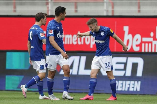 Schalke's English defender Jonjoe Kenny earned his side a point at Union Berlin with a powerful long-range shot (AFP Photo/Michael SOHN)