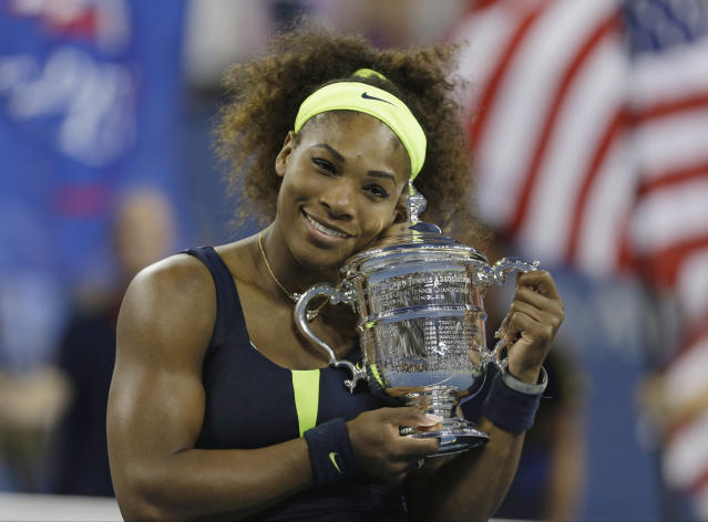 FILE - In this Sept. 9, 2012, file photo, Serena Williams holds the championship trophy after beating Victoria Azarenka, of Belarus, in the championship match at the 2012 US Open tennis tournament in New York. Serena Williams is planning to play in the 2020 U.S. Open. The 23-time Grand Slam singles champion said in a video shown during the U.S. Tennis Association's tournament presentation Wednesday, June 17, 2020, that she cannot wait to return to New York for the major championship she has won six times. (AP Photo/Mike Groll, File)