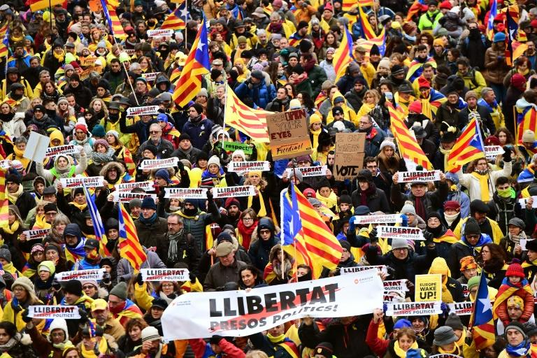 """Demonstrators chanted """"Wake up Europe!"""" and waved Catalonia's red, yellow and blue separatist flag as they marched past the European Union headquarters in the Belgian capital"""