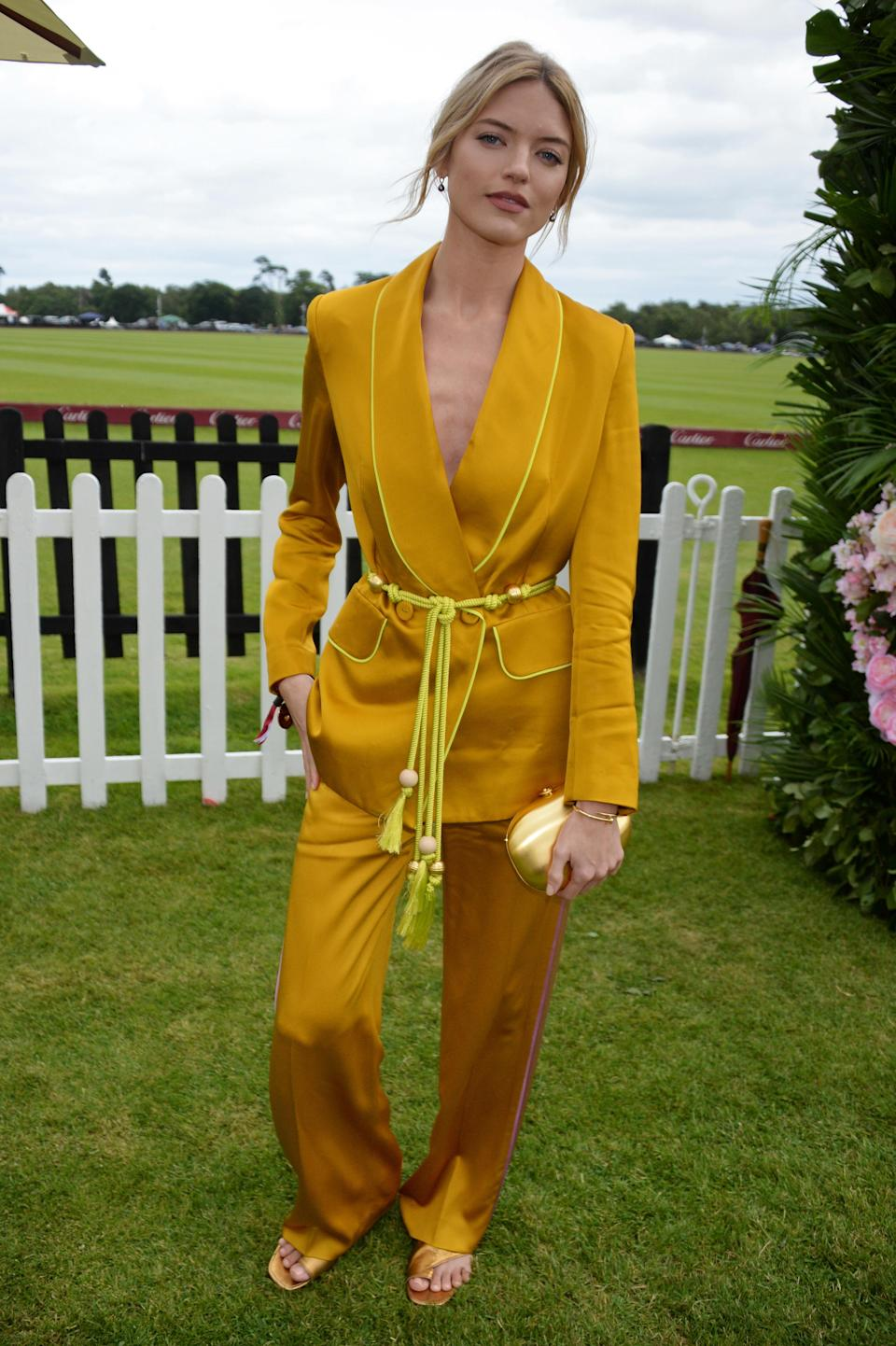 <p>Martha Hunt joined a gaggle of A-list guests at the Cartier Queen's Cup Polo in a silky mustard two-piece. We need to know where we can bag one immediately. <em>[Photo: Getty]</em> </p>
