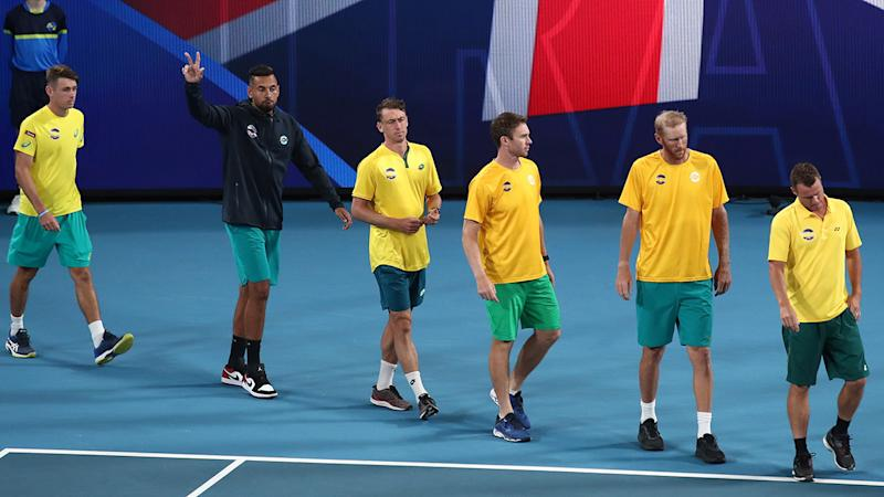 Lleyton Hewitt, pictured here leading his team onto the court prior to their semi-final against Spain.