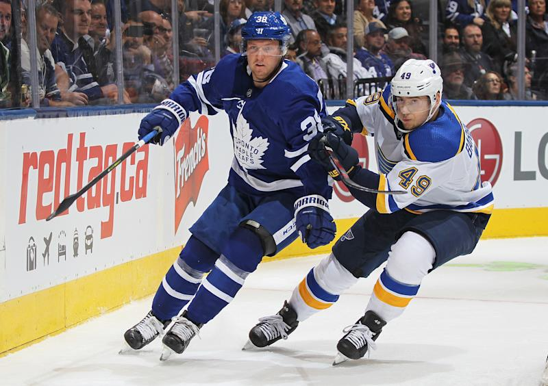 TORONTO, ON - OCTOBER 7: Ivan Barbashev #49 of the St. Louis Blues skates against Rasmus Sandin #38 of the Toronto Maple Leafs during an NHL game at Scotiabank Arena on October 7, 2019 in Toronto, Ontario, Canada. (Photo by Claus Andersen/Getty Images)