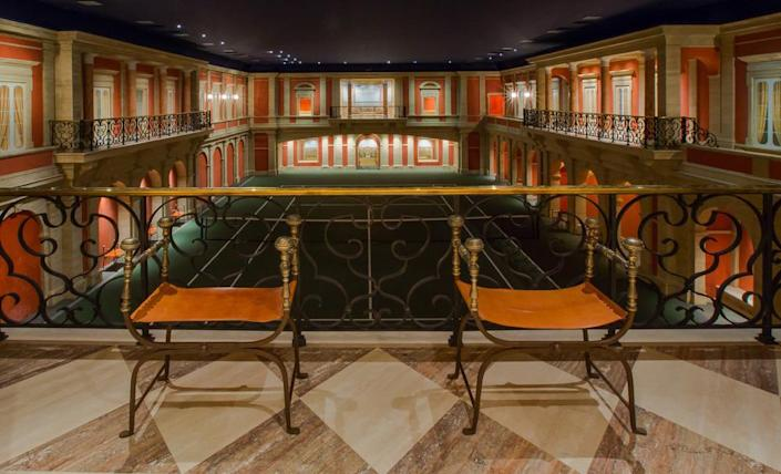<p>And now let's go downstairs. The regulation tennis court, which converts into a neo-Classical ballroom, is 50 feet underground, so noise is never an issue for the neighbors. (Photo by Steve Brown/Sepia Productions)</p>