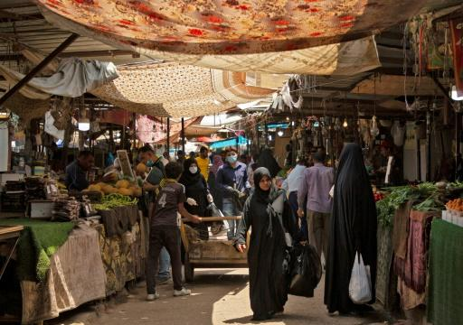 Iraqis walk through a fresh produce market in the southern Iraqi city of Basra as some lockdown restrictions imposed during the novel coronavirus pandemic have been eased