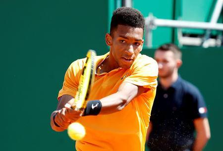 FILE PHOTO: Tennis - ATP 1000 - Monte Carlo Masters - Monte-Carlo Country Club, Roquebrune-Cap-Martin, France - April 17, 2019 Canada's Felix Auger Aliassime in action during his second round match against Germany's Alexander Zverev REUTERS/Eric Gaillard