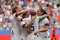 Megan Rapinoe of the USA celebrates with her team mates after scoring her sides first goal from the penalty spot during the 2019 FIFA Women's World Cup France Round Of 16 match between Spain and USA at Stade Auguste Delaune on June 24, 2019 in Reims, France. (Photo by Robert Cianflone/Getty Images)