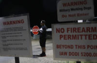 """A man stands at an entrance to the Nevada Test and Training Range near Area 51 Friday, Sept. 20, 2019, near Rachel, Nev. People gathered at the gate inspired by the """"Storm Area 51"""" internet hoax. (AP Photo/John Locher)"""