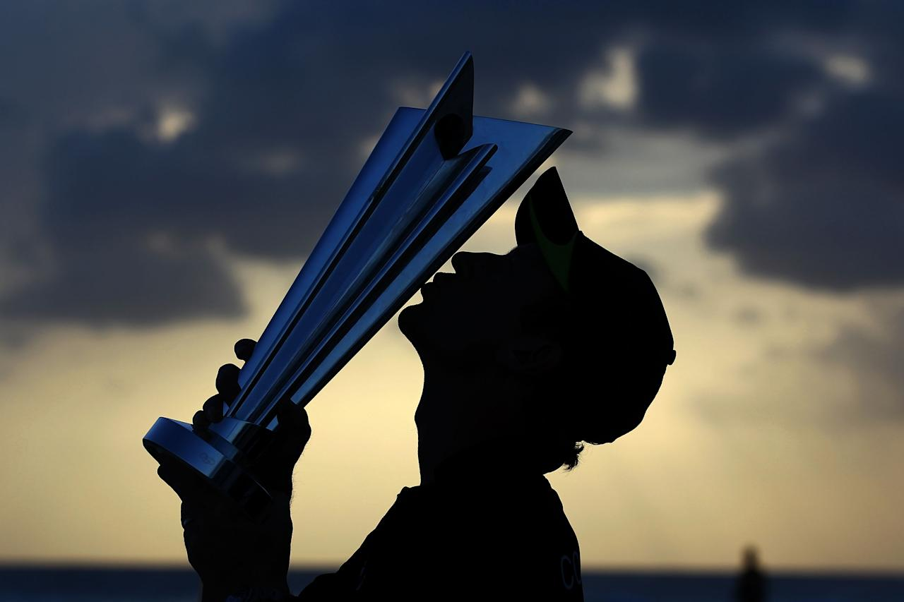BRIDGETOWN, BARBADOS - MAY 16:  Paul Collingwood of England kisses the ICC World Twenty20 trophy on the beach after the final of the ICC World Twenty20 between Australia and England at the Kensington Oval on May 16, 2010 in Bridgetown, Barbados.  (Photo by Clive Rose/Getty Images)