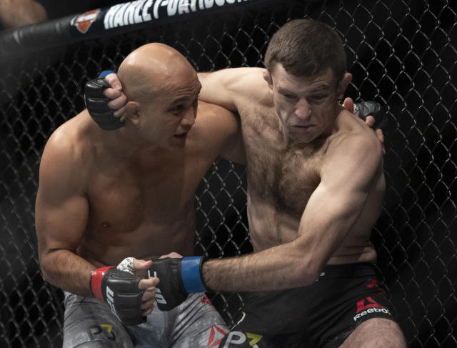 BJ Penn, left, and Ryan Hall fight during the first round of a lightweight mixed martial arts bout at UFC 232, Saturday, Dec. 29, 2018, in Inglewood, Calif. (AP Photo/Kyusung Gong)