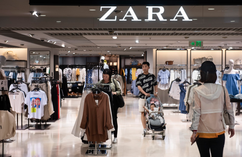 Shoppers peruse a Zara store. The chain has pledged to go 100% sustainable by 2025. (Photo: Getty)