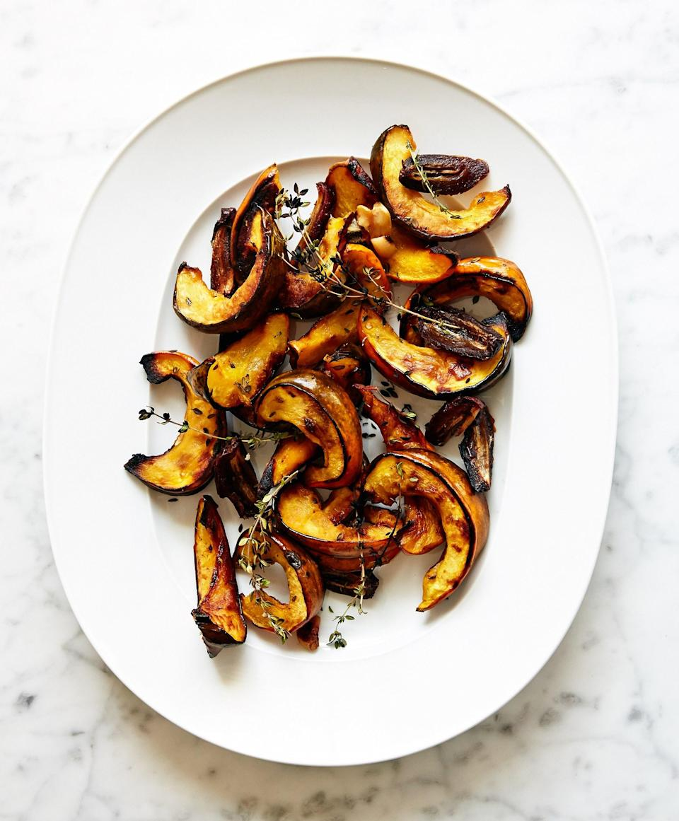 """The sweetness of the acorn squash, dates, and coconut oil in this simple roast is balanced by the garlic and woodsy herbs. <a href=""""https://www.bonappetit.com/recipe/squash-with-dates-and-thyme?mbid=synd_yahoo_rss"""" rel=""""nofollow noopener"""" target=""""_blank"""" data-ylk=""""slk:See recipe."""" class=""""link rapid-noclick-resp"""">See recipe.</a>"""