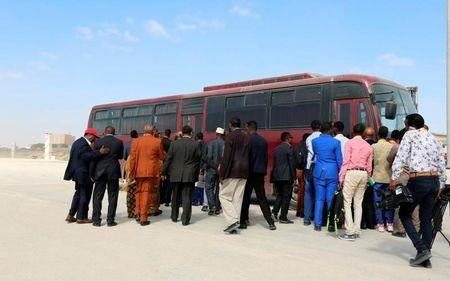 Somali lawmakers and journalists board a chartered bus to the venue of the elections during the presidential vote at the airport in Somalia's capital Mogadishu February 8, 2017. REUTERS/Feisal Omar