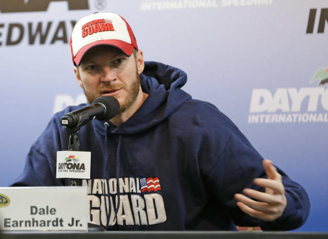 NASCAR driver Dale Earnhardt Jr. answers questions during a news conference at Sprint Cup auto racing testing at Daytona International Speedway in Daytona Beach, Fla., Friday, Jan. 10, 2014.(AP Photo/John Raoux)