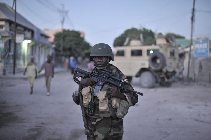 An African Union soldier is seen patrolling a street in Mogadishu, Somalia, on May 25, 2013