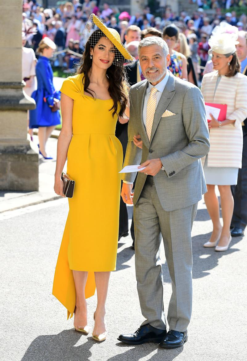 WHO: Amal Clooney WHAT: Custom Stella McCartney, Gianvito Rossi shoes, Lorraine Schwartz jewelry and a Stephen Jones hat WHERE: At the royal wedding, Windsor, England WHEN: May 19, 2018