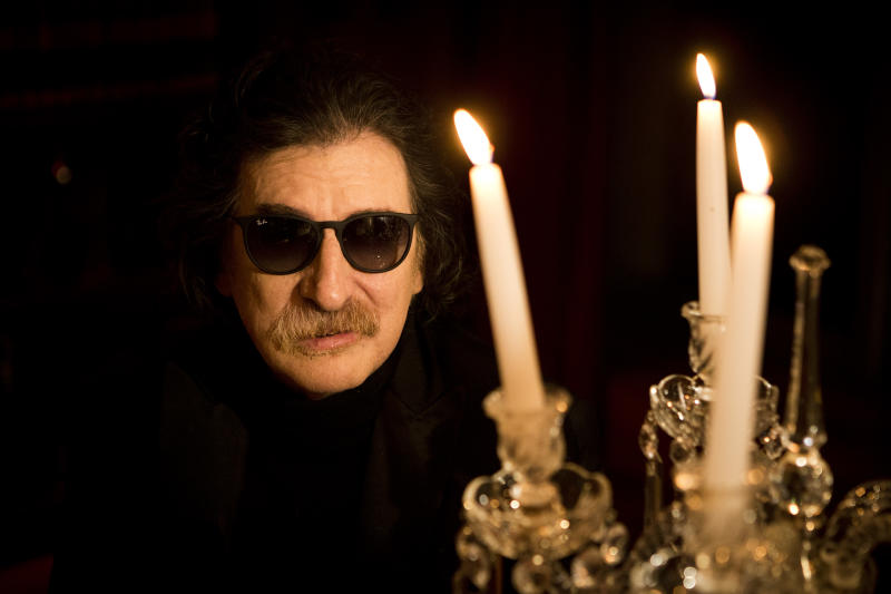 Argentine rock legend Charly Garcia poses for a portrait before an interview in Buenos Aires, Argentina, Wednesday, Aug. 14, 2013. Garcia, who is 61 and has a vast career that defined and inspired the rock and pop music world in Latin America, will perform two shows at Teatro Colon, Argentina's landmark opera house, on Sept. 23 and 30. (AP Photo/Victor R. Caivano)