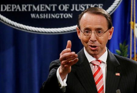 FILE PHOTO: Deputy U.S. Attorney General Rod Rosenstein announces grand jury indictments of 12 Russian intelligence officers in special counsel Robert Mueller's Russia investigation, during a news conference at the Justice Department in Washington, U.S., July 13, 2018. REUTERS/Leah Millis/File Photo