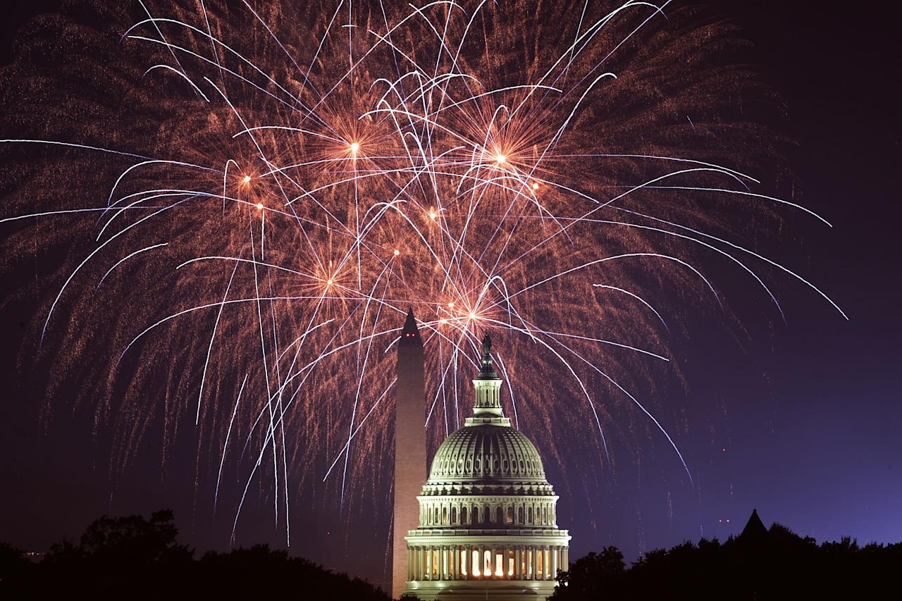 <p>Fireworks explode overhead at the U.S. Capitol and the Washington Monument on Independence Day July 4, 2018 in Washington, D.C. (Photo: Alex Wong/Getty Images) </p>