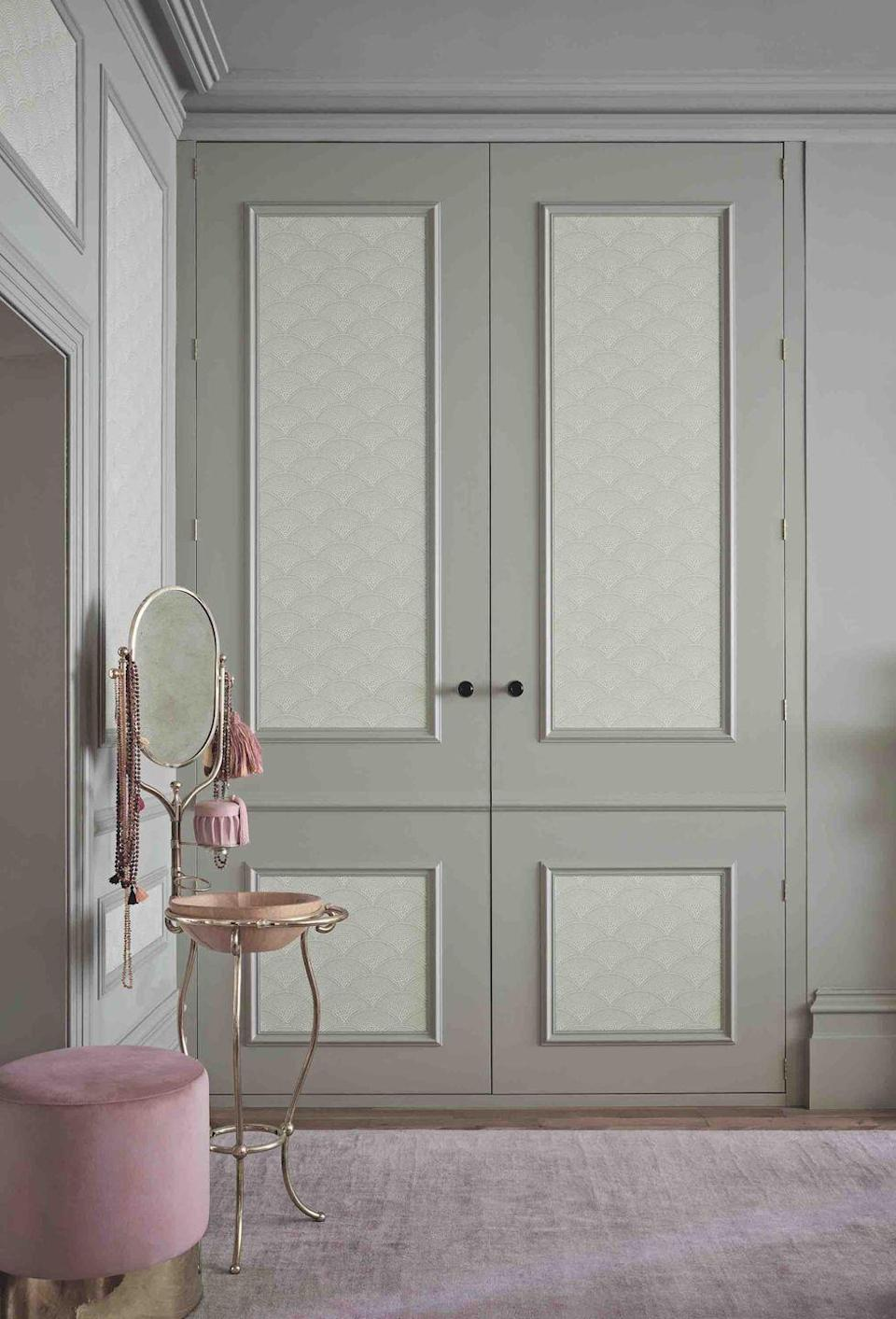 """<p>Pale grey is such a great colour for cupboards as it's calming and softer than stark white. To recreate this grey bedroom idea, add patterned wallpaper in the panels to create interest and give the room a French boudoir look.</p><p>Top Tip: An alternative to wallpapering in the panels, is to use a different coloured paint or stencil a design on them.</p><p>Pictured: <a href=""""https://cole-and-son.com/en/products/feather-fan?v=3802"""" rel=""""nofollow noopener"""" target=""""_blank"""" data-ylk=""""slk:Feather Fan wallpaper in Soft Olive, from Cole & Son"""" class=""""link rapid-noclick-resp"""">Feather Fan wallpaper in Soft Olive, from Cole & Son</a>. A similar paint colour is <a href=""""https://go.redirectingat.com?id=127X1599956&url=https%3A%2F%2Fwww.johnlewis.com%2Fthe-little-greene-paint-company-intelligent-matt-emulsion-light-greys%2Finox-224%2Fp1492499&sref=https%3A%2F%2Fwww.housebeautiful.com%2Fuk%2Fdecorate%2Fbedroom%2Fg35432015%2Fgrey-bedroom-ideas%2F"""" rel=""""nofollow noopener"""" target=""""_blank"""" data-ylk=""""slk:Inox from Little Greene"""" class=""""link rapid-noclick-resp"""">Inox from Little Greene</a>.</p>"""
