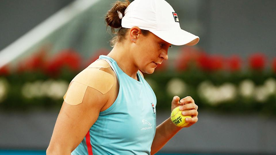 Ash Barty, pictured here with her shoulder strapped as she beat Shelby Rogers at the Madrid Open.